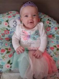 photo-WIFC-Baby-magic-onesie-1-e1555599337888-400x533