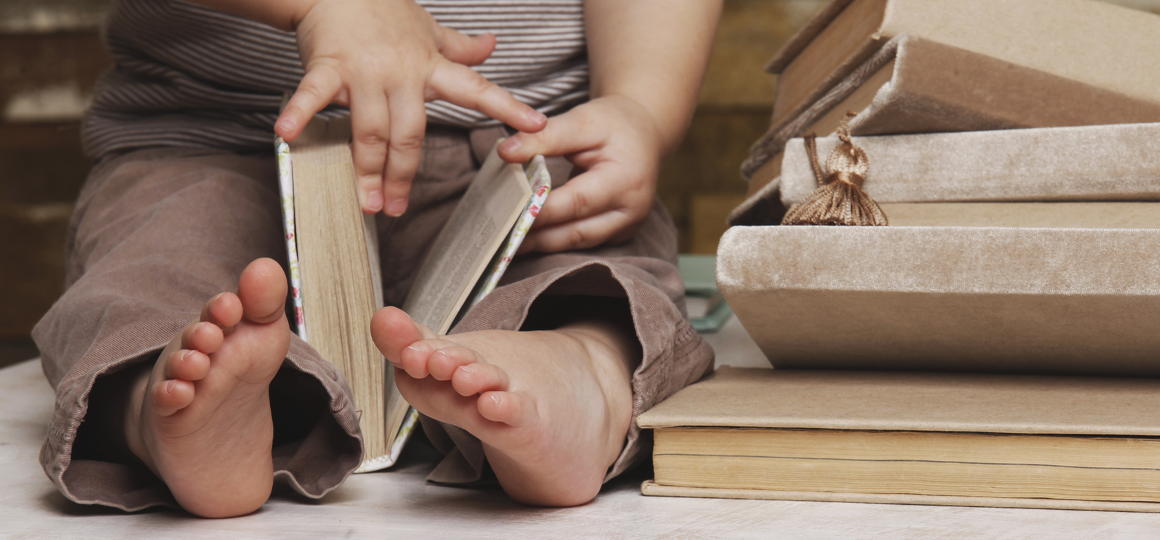 photo-toddler-with-book-web